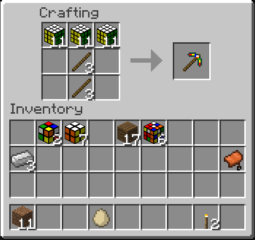 Crafting cubes into a pickaxe, standard recipie with sticks.